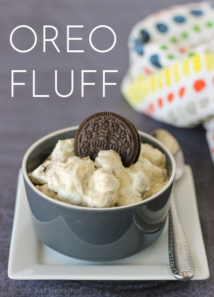 image labeled Oreo Fluff with gray bowl filled with dessert fluff and topped with an Oreo cookie