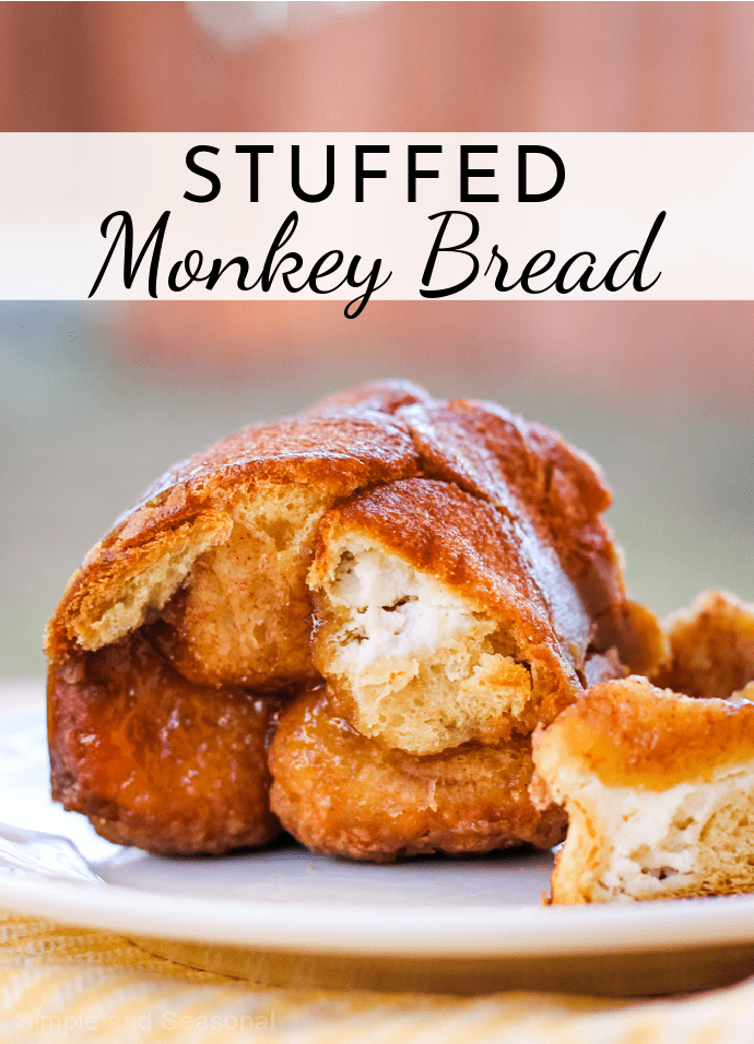 Golden flaky bread, cream cheese filling and a buttery brown sugar syrup make Cream Cheese Stuffed Monkey Bread the perfect treat! via @nmburk