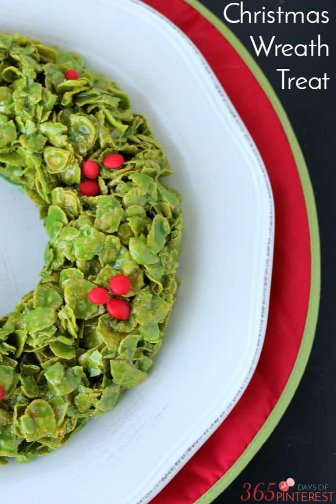 A gooey, sweet and delicious treat that's perfect for Christmas parties, this Christmas Cornflakes Wreath comes together in less than 10 minutes! via @nmburk