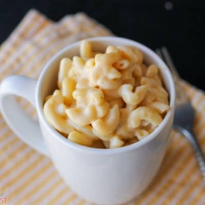 Save yourself from powdered cheese and overpriced cup-o-questionable-ingredients! :) You can make microwavable Mug Macaroni and Cheese in the same amount of time and it's so much better with rich grown-up cheeses.
