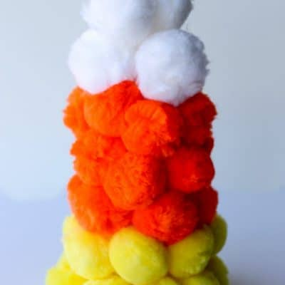 This easy and colorful Pom Pom Candy Corn is the perfect kids' craft for fall! Just don't try to eat it! ;)