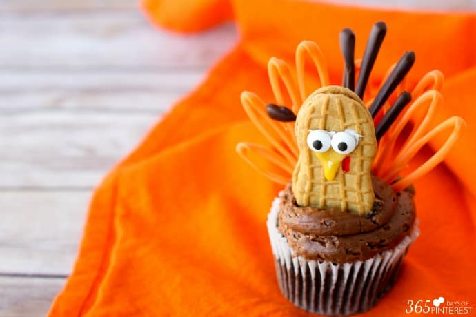 Celebrate Thanksgiving with these adorable little turkey cupcakes! Peanut butter bodies and candy feathers mean you can have turkey for dessert, too. ;)