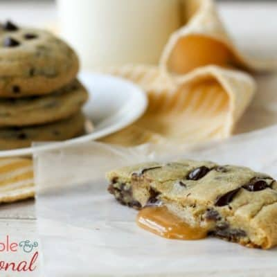 Caramel Stuffed Chocolate Chip Cookies are cookie perfection. These jumbo cookies are just begging to be enjoyed with a glass of milk on a cool fall evening!