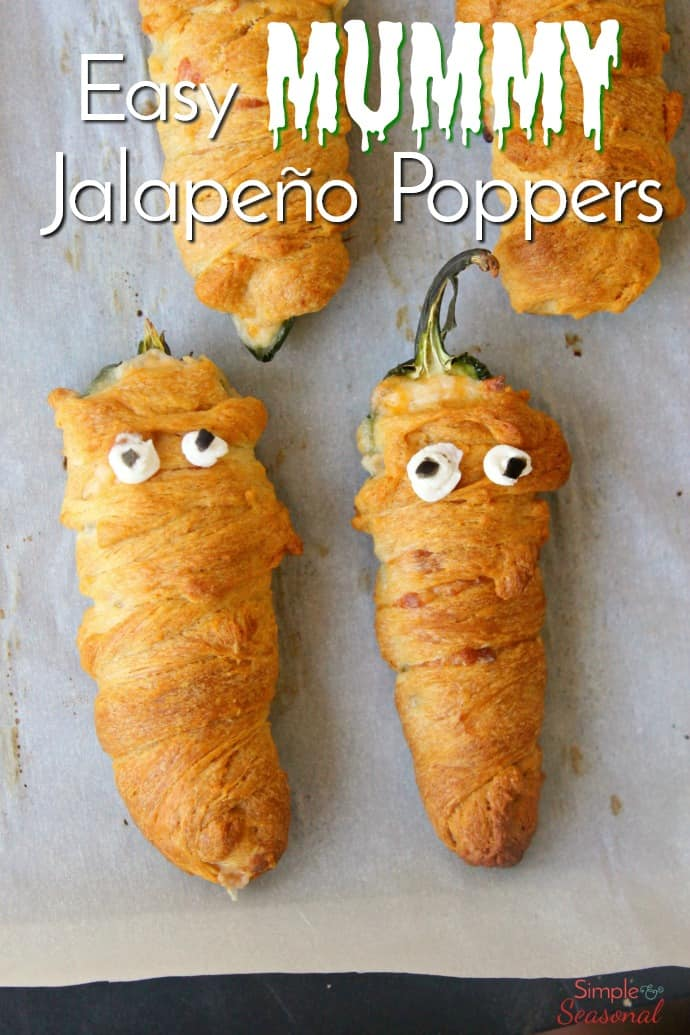 A little twist on the classic appetizer, these Mummy Jalapeño Poppers are a fun Halloween snack! The buttery, flaky crust wrapped around a creamy filling goes perfectly with the spicy jalapeño. #Halloween #easyappetizer #halloweenfoodideas #jalapeno #appetizers via @nmburk
