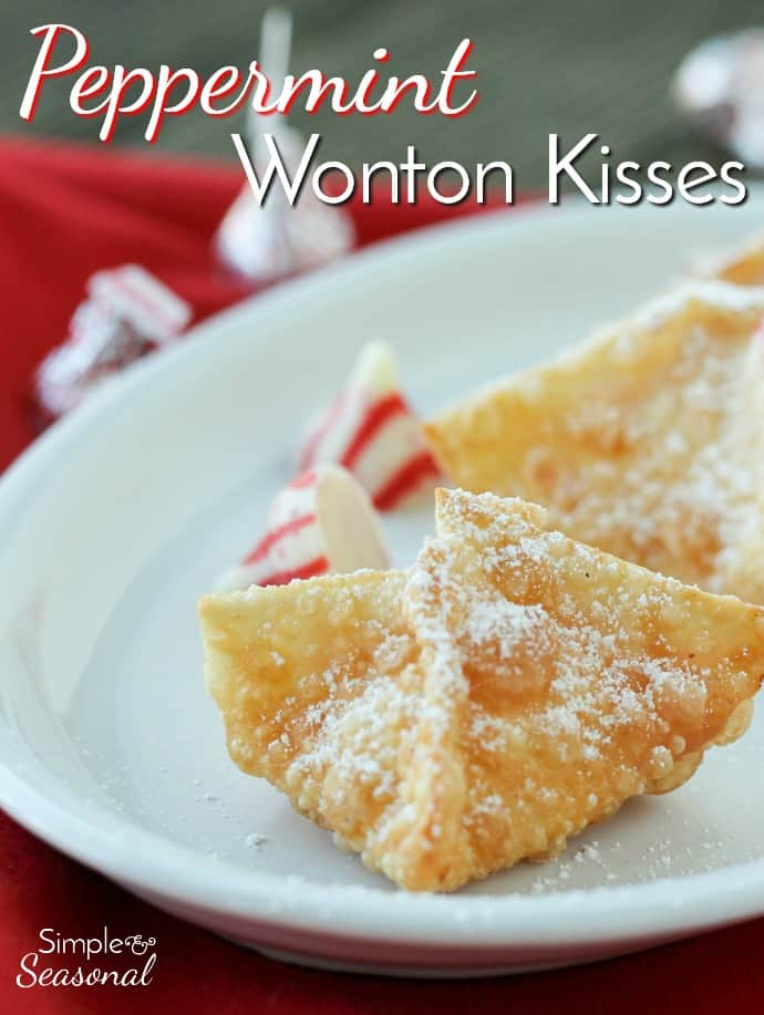 These cute little Peppermint Wonton Kisses are filled with Hershey's Kisses candy and only four ingredients. They are a super easy Christmas dessert and perfect for your holiday party or Christmas Cookie Swap! via @nmburk