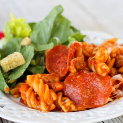 Crockpot Express Pizza Pasta is a family friendly dinner that you can easily adjust with your own favorite pizza toppings! Serve with breadsticks and salad for a satisfying and delicious dinner.