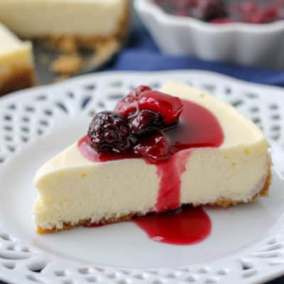 Crockpot Express Cheesecake with Triple Berry Sauce