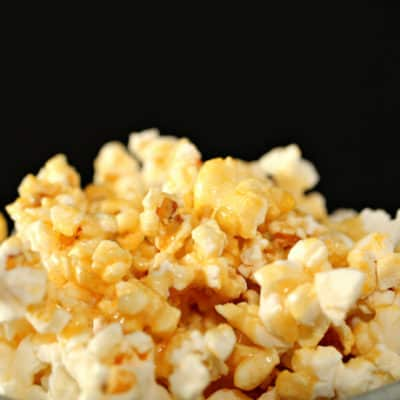 closeup of marshmallow caramel sauce poured over popcorn