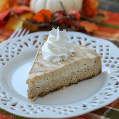 You're going to love this smooth and creamy Crockpot Express Pumpkin Cheesecake! It's made with a spicy gingersnap crust and is bursting with fall flavors!