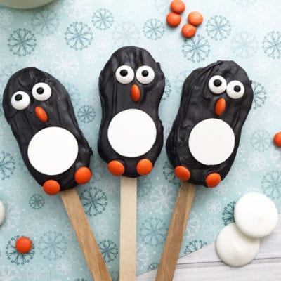 "Celebrate winter, Christmas and all things ""penguin"" with these easy Penguin Nutter Butters! They are an adorable no bake treat perfect for cookie exchanges or fun with the kids."