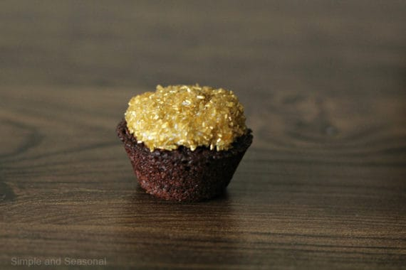 brownie bite topped with gold sprinkles