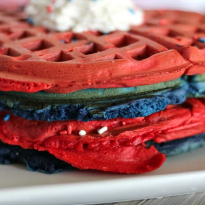 close up of red and blue 4th of July waffles with whipped topping