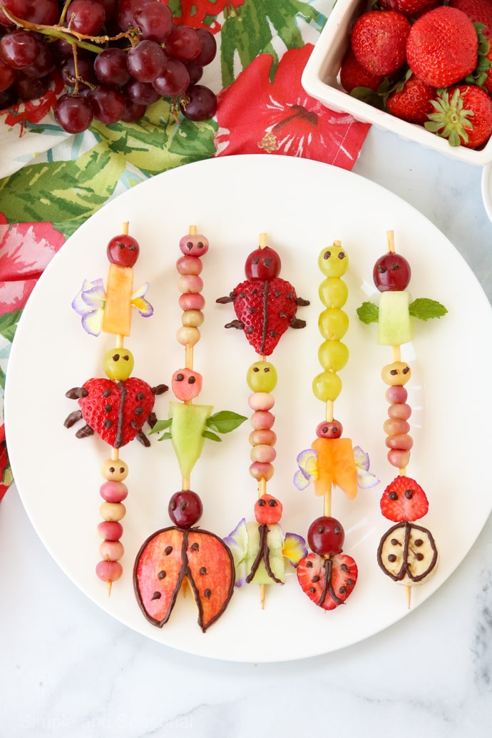 Serve a fun after school snack or impress party guests with these yummy and cute Critter Fruit Kabobs! Perfect Timon and Pumbaa snacks for a Lion King Party via @nmburk