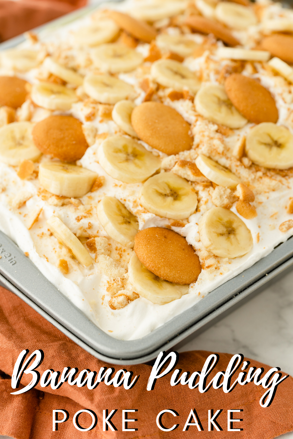 Enjoy the classic flavors of banana pudding in this moist and delicious Banana Pudding Poke Cake! via @nmburk