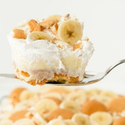 slice of banana pudding poke cake on serving spatula
