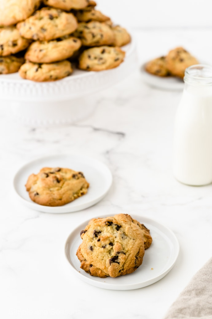 chewy chocolate chip cookies on a plate with milk