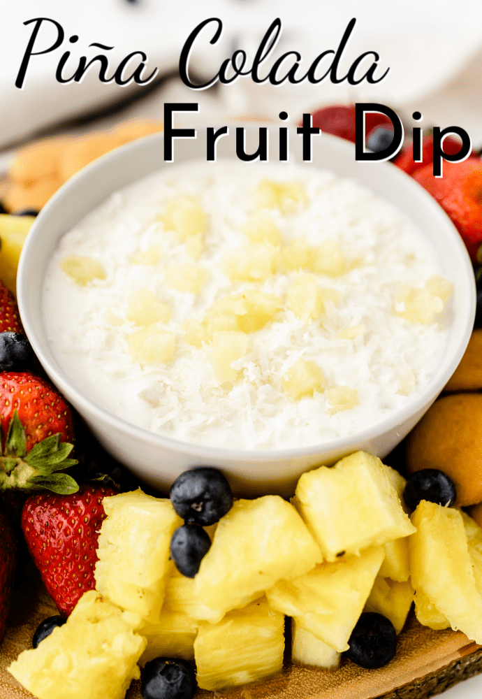 platter of fruit with white bowl of piña colada fruit dip