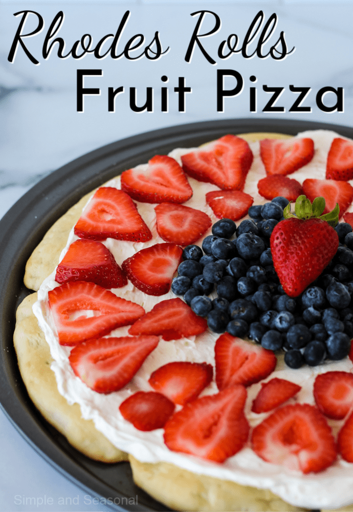 whole fruit pizza in the pizza pan with a label that reads: rhodes rolls fruit pizza