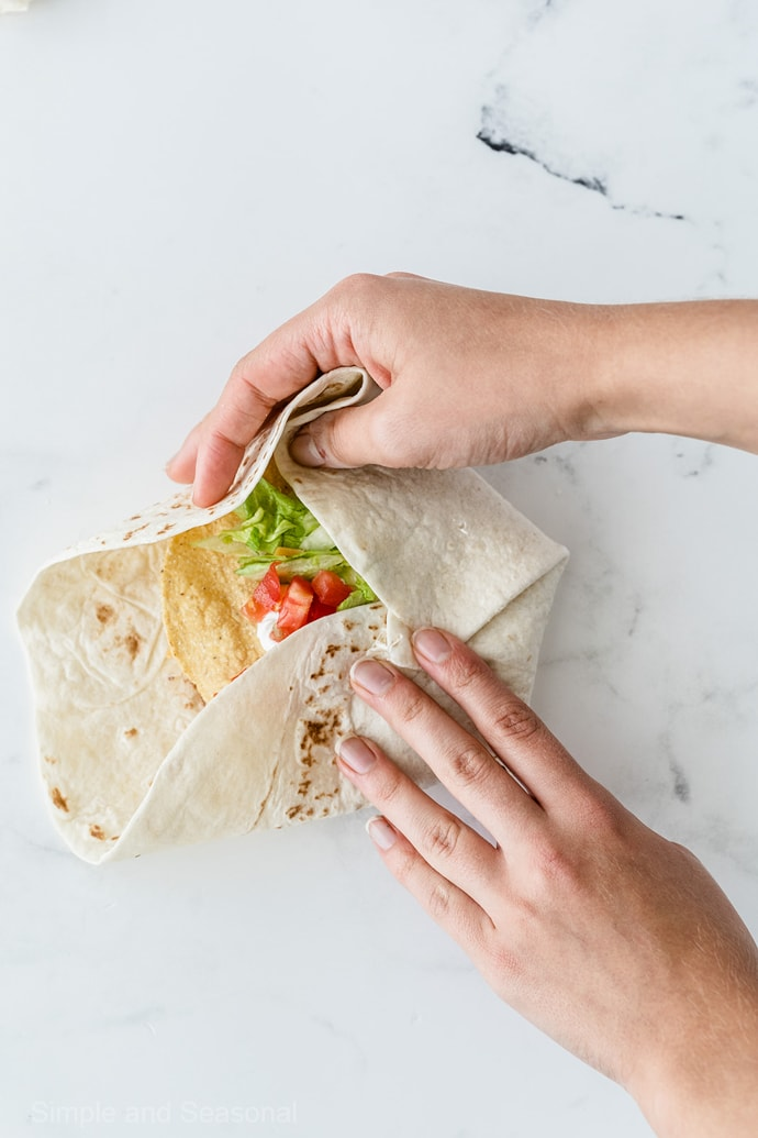 folding flour tortilla around center