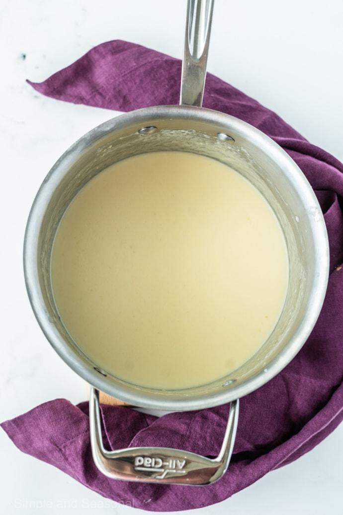 alfredo sauce in a pot