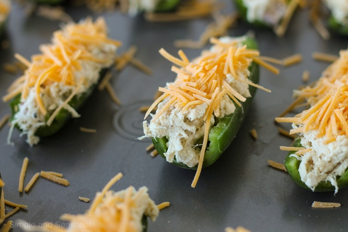 jalapeno stuffed with crack chicken and topped with cheese