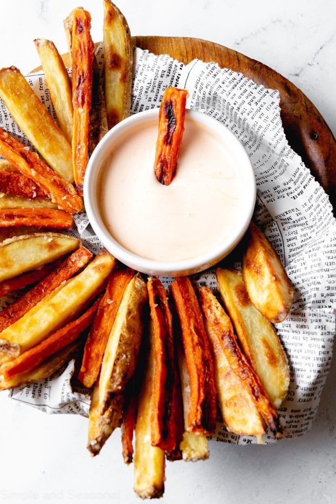 baked carrot fries on a serving platter