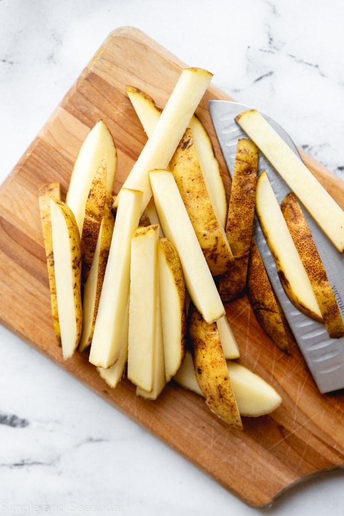 cut potato sticks on a cutting board