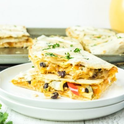 two quesadillas on a plate with the sheet pan in the background