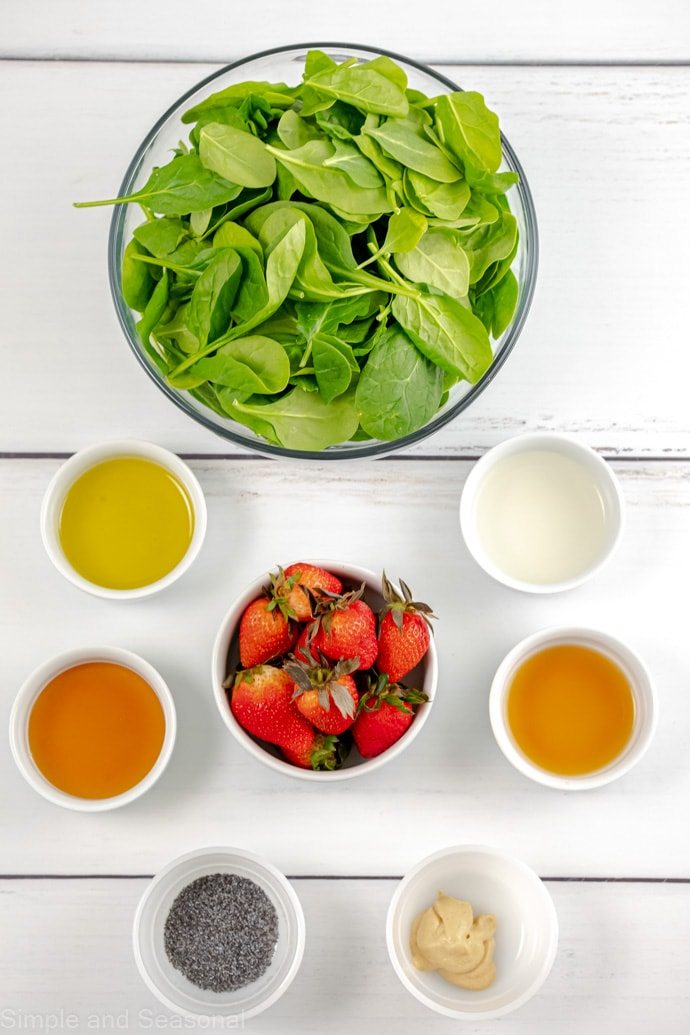 ingredients for honey dijon dressing and spinach salad