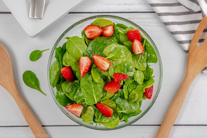 spinach strawberry salad in a bowl
