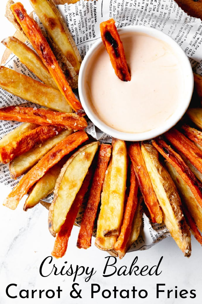 baked carrot fries and potato fries on a round serving platter with chipotle mayo dipping sauce